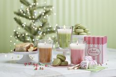"Just Desserts™ by PartyLite Scented Jar Candles  The look of a layered parfait treat, playfully packaged in a candy striped box. Delight in the mouthwatering scent of   G14779 $20.00 Lemon Lime Macaron  G14775 $20.00 Apple Strudel G14777 $20.00 Marshmallow Peppermint 4¾""h, 3½""dia. Burn time: 40-50 hours. P91120 $10.00 Petite Desserts Candle Holder."
