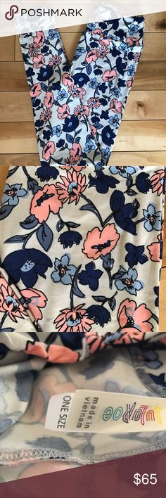 UNICORN Lularoe Floral OS leggings UNICORN Lularoe floral OS leggings.   Beautiful OS legging with vet light gray background with pink navy and other shades of blue flowers.  Bundle for additional discounts or make me an offer. LuLaRoe Pants Leggings