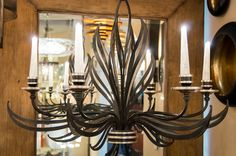 Fine Art Lamps Villandry chandelier features black and silver two-tone metal work that looks almost like flames.  Hand blown glass candle covers.  At Northwest Lighting and Accents in Mount Prospect, IL. @nwlighting @fineartlamps