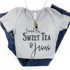 """This is a super-soft fitted ladies tee with our """"Raised On Sweet Tea & Jesus"""" design. Fit: Women's & runs slightly small. *Heather grey with black text"""