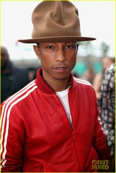 Celeb Diary: Pharrell Williams with his wife Helen Lasichanh attends the 2014 Grammy Awards