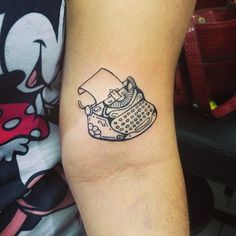 Tattoo typewriter, this is cute!