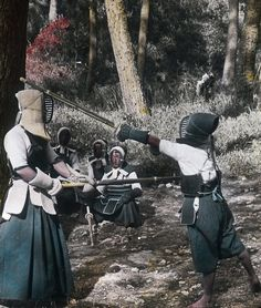 Hand-colored photo of men practicing 'kendo' (Japanese sword fighting martial arts). 1900-1910, Japan. Photographerunknown