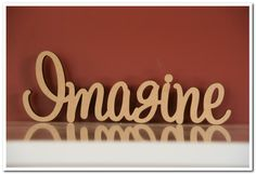 Custom made freestanding wooden word  Imagine  10cm tall. Made in raw(unpainted) 12mm thick MDF.  If you want to buy it  please contact us for a quote  http://www.decoroo.com.au/contact-us/