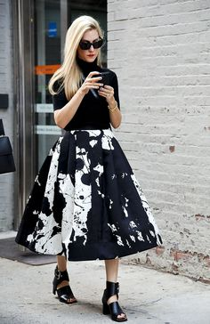 Joanna Hillman made ladylike look so cool in a paint-splattered Tibi Resort 2014 skirt.   Download the app today: https://purelyapp.com