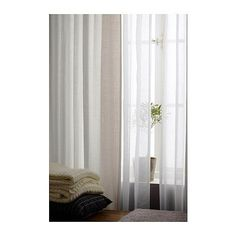 Curtains currently in the family room - RITVA Curtains from IKEA.  BUT, maybe add sheer panels behind the RITVA panels for a more layered look to add greater texture to the room.