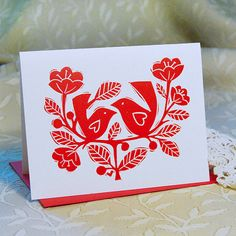 Letterpress printed in red ink on a speckled white recycled card stock from my hand cut linoleum block. Each card comes with coordinating red