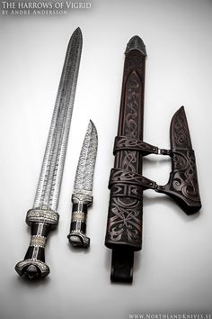 The Vigrid by Andre Andersson Blade sword:3 bar mosaic damascus. Blade knife:5 bar mosaic damascus. Steels:Uddeholm 15N20 and 15LM. Handle:Ebony, damascus steel and 925 etched silver. Sheath:Ornamented rawhide leather sheaths. Total length sword: 83cm (32.677 inch), Weight without sheath 1.45kg (3.196 pund) Total length knife: 37cm (14.566 inch), weight 0,75kg (1.653 pund)