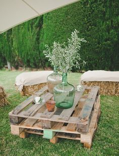 Pallet table by a fire pitt