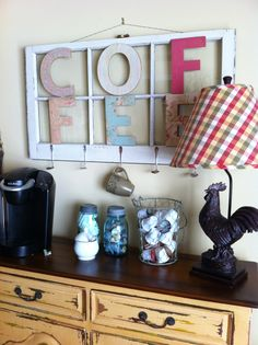 my coffee bar - old window, antique spoons bent to hold mugs, letters covered with scrapbook paper