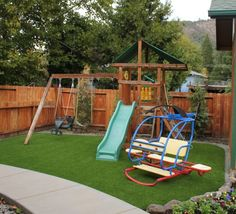 Here's another backyard project where the parents treated their kids to soft fall protection with a cushioned pad below artificial playground grass.