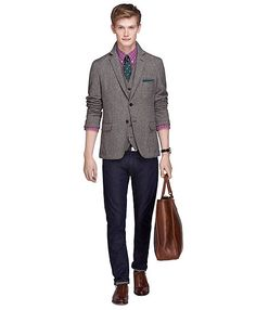 Fun color combinations in the shirt and tie  make this jeans and sport coat combo stylishly unique.  The tie and shirt colors are toned down by the neutral sport coat which is why this works on the low contrast model.