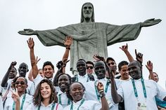 Athletes of the Refugee Olympic Team (ROT) in front of the statue of Christ the Redeemer Rio 2016 Olympic