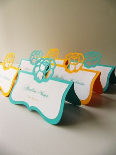 Something like this, only with the same flower as the rest of the theme, in the blue for your buffet descriptions.