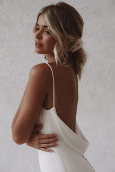 Archie is a sexy and sophisticated combination of both modern and classic. Made with seamless soft, double french crepe, her figure hugging design is created to completely celebrate every curve and turn of the body while draping dramatically with her signature cowl back. #felicitysbridalnz #weddingnz #bridenz #madewithlovebridal #mwlarchie Affordable Wedding Dresses, Bohemian Bride, Crepe Fabric, Intimate Weddings, Archie, Bridal Collection, Trendy Wedding, Dress Making, Wedding Events