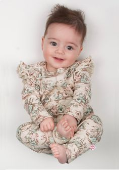 Adorable vintage swan print onesie with frill sleeves! Available now from www.ohbabylondon.com