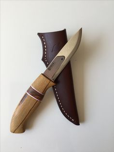 HELLE bushcraft knife with handmade marble wood and leather sheath
