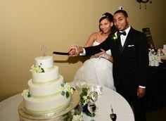 Latosha and Terrance cutting their wedding cake at The Centre @ Arbor Connection. Douglasville, GA weddings,