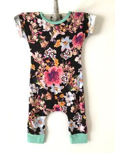 This short sleeved buttery soft black romper has a lovely floral print. Material is light to mid weight and made from a very soft black cotton spandex rayon blend knit with a 4-way stretch to keep you