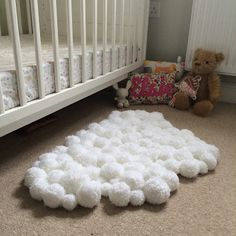 DIY pompom rug in a cloud shape for children room nursery, adds lots of texture and has lots of sensory appeal for a baby or toddler. Pom Pom Craft Wind the Bobbin Up