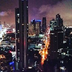 Panama City, Panama shows an elevated view of the city depicting the heartbeat and culture of this country on a moonless dark sky.