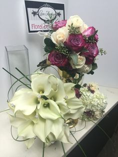Bridal bouquet and maid of honour. White calalilly and MOH purple and ivory rose