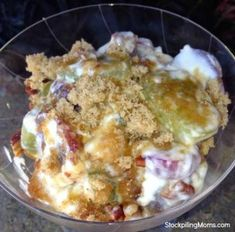 Grape Salad is a favorite side dish at our house! I made this for Thanksgiving and everyone loved it. It is so easy to prepare and inexpensive when grapes are on sale. You can't go wrong with this delicious combination. You can toast your pecans if you desire and that really steps up the final product. To prepare beat together the sour cream, cream cheese, vanilla and sugar (or splenda) until creamy. Fold in grapes (cut in half if they are over sized). Mix together for topping the fine...