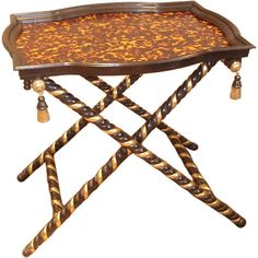 1STDIBS.COM - William R. Eubanks Interior Design, Inc. - Faux Finished Tortoise Shell Tray Table found on Polyvore