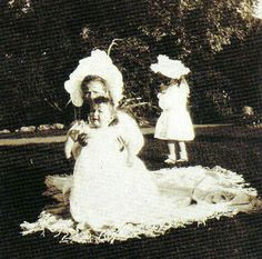 "Grand Duchess Olga Nikolaevna Romanova of Russia holding onto her brother,Tsarevich Alexei Nikolaevich Romanov of Russia.Grand Duchess Anastasia Nikolaevna Romanova of Russia is in the background.Photo taken at Peterhof in 1905. ""AL"""
