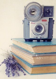 """""""Vintage and Volumes""""- My cute vintage Starmite camera on old books. Blue, grey and lavender art. Great for a library or office. By kelly*n photography"""