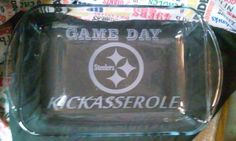 :) GREAT FOR GETTING YOUR DISH BACK AT PARTIES OR SHOWING OFF YOUR KICKASSEROLE AND TEAM SPIRIT. COMES WITH THE LID.  1. Purchase the pictured team or let us know your team in the notes section at checkout.  Need a different design or more customizing please request a CUSTOM ORDER-   The listing is for a custom etched Casserole dish large size. Steelers logo with GAMEDAY at the top and KICKASSEROLE at the bottom. This etching will NOT fade, wash off or affect the the dish in anyway…