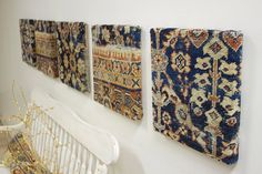 Cool decorating idea for Persian rugs past their prime: cut & stretch over frames & hang as wall art.