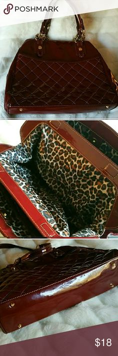 Burgandy cranberry elegant bag Make a chic statement with this cranberry wine burgandy purse with gold handles and cheetah interior for those working ladies. 3 compartments inside with center magnetic closure additional side walls with 2 inside zipper compartments 11.5x16 carry many many things Maxx New York  Bags Shoulder Bags