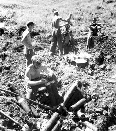A US Army mortar crew of an M1 81mm mortar in action on Guadalcanal - 1942
