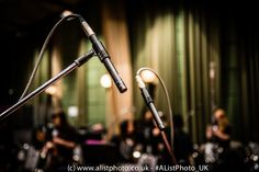 #Microphone set-up to record some of the instruments.  You can see the Orchestra in the background.