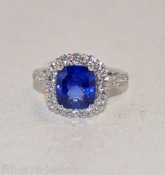 4.37ct sapphire solitaire ring w/diamond halo-18kt