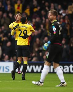 Etienne Capoue of Watford celebrates scoring his sides first goal with Roberto Pereyra of Watford during the Premier League match between Watford and Leicester City at Vicarage Road on November 19, 2016 in Watford, England.