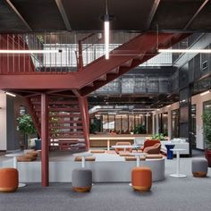 The narrative of the new Miral headquarters in Abu Dhabi is undeniably employee-centric. Designed by GAJ Architects, it explores a progressive work environment beyond the norm. Tiered Seating, Indoor Slides, Communal Table, Play Pool, Office Interior Design, Office Designs, Architecture Office, Wood Accents, Abu Dhabi