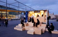 Here's a look at the food truck in action, with seating spaces assembled in a public space.
