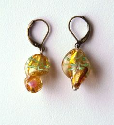 bronze-colored earrings with gold colored hand made twisted Murano glass beads