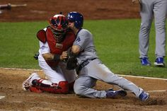 Mark Ellis of the Los Angeles Dodgers is out at home plate in the 10th inning against Yadier Molina during Game 1 of the NLCS. Cards won the game 3-2 in the 13th.  10-11-13