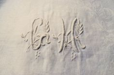 Six lovely napkins in a white damask pure linen, with a hand embroidered monogram CH (or GH ?)  Size of the napkins around 31,49 X 26,37 inch