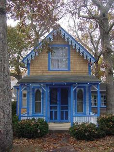 Donna's Corner~~Things I Love     ~ Love this cute Cottage ~ looks like a Miniature Victorian ~ Gingerbread around the Roof ~ Shake Shingles ~ and a pretty Porch ~ love the colors also ~ total charm ~ ♥ :)