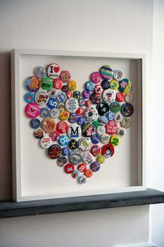 DIY Bottle Cap Art or with buttons or pins. Finally something to do with all my kids' baseball pins/buttons! Bottle Cap Art, Bottle Cap Crafts, Diy Bottle, Beer Bottle, Plastic Bottle, Button Art, Button Crafts, Heart Button, Button Badge
