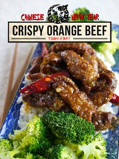 Crispy Orange Beef - 1 lb top blade steaks -1/4 cup white sugar -1/3 cup rice wine vinegar -1/3 cup freshly squeezed orange juice -1 tsp salt -1 tbs soy sauce -1 tsp hoisin sauce -1/4 cup cornstarch -Peanut oil for frying -2 tsp orange zest -2 tbs grated fresh ginger -2 cloves garlic, minced -8-10 dried red chiles japoneses -2 cups cooked rice -8 broccoli florets, lightly steamed or blanched