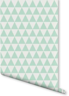 On the lookout for playful wallpaper designs? This mint green and white triangular pattern would look wonderful in kid's rooms. Playing with a sense of scale, these small triangles can even make small spaces appear bigger!