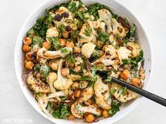 This Roasted Cauliflower Salad combines sweet roasted red onions, spiced chickpeas, tender cauliflower, and a tangy lemon tahini dressing.