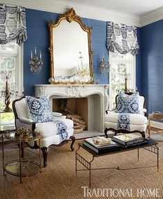 Pretty blue-and-white room by Megan Winters with gorgeous carved #fireplace mantel.