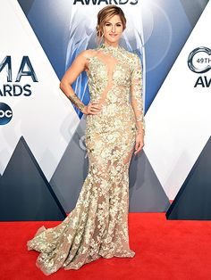The Sparkliest, Sexiest and Sweetest Looks at the CMAs!   CASSADEE POPE   wears a rose-embroidered illusion tulle dress with a trumpet hem and coordinating cuff.