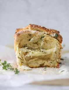 This garlic pull apart bread is the most delicious way to eat your garlic bread! Flakey delicious layers covered with roasted garlic, parmesan and herbs!